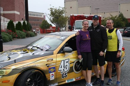 Race car driver & 5K sponsor Al Carter stands between Trish & Rich Szymanski